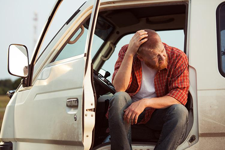Farmer experiencing stress. Photo courtesy of Getty Images.