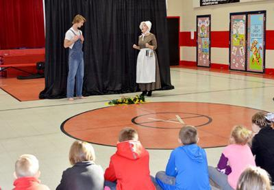 "Eli Raby, left, and Anne Stephens act out a scene from Jesse Stuart's ""Old Ben"" for Argillite Elementary third-graders."