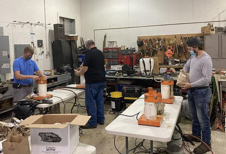 From left: Reed Graham, Breathitt County agriculture and natural resources extension agent, David Appelman, Bracken County agriculture and natural resources extension agent, and Dalton May, Perry County intern prepare hay samples for testing at RCARS.