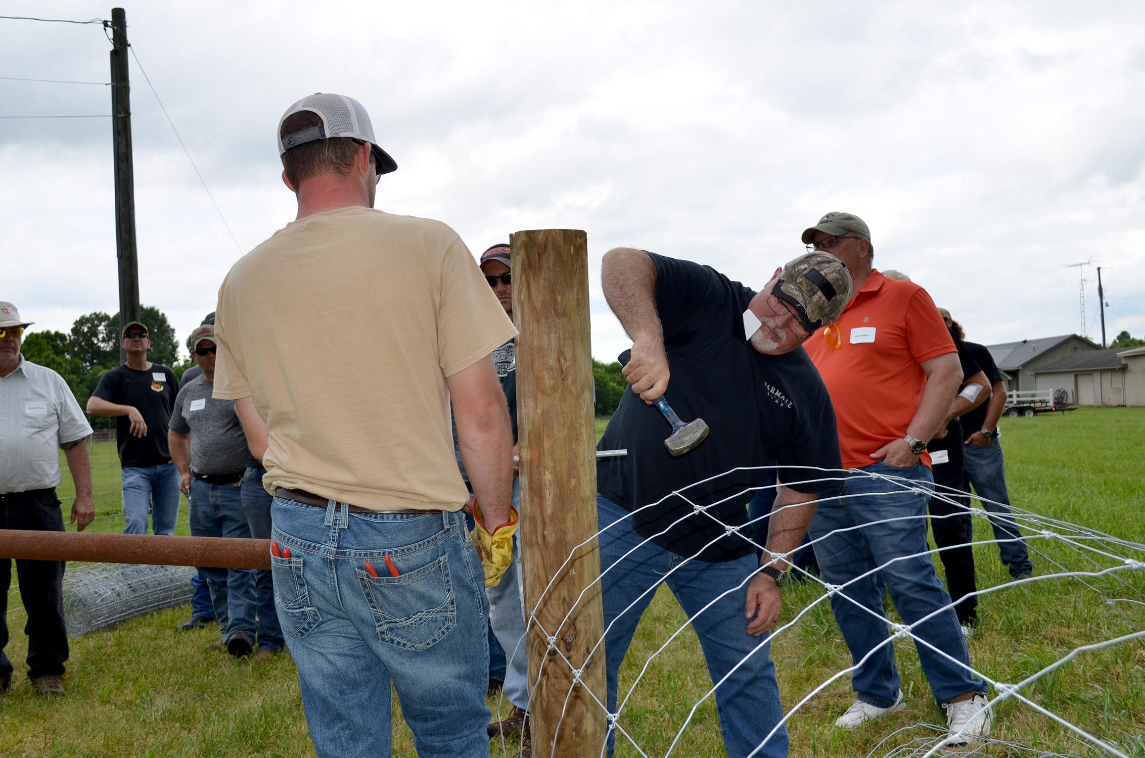 Butch King, Kentucky Fencing School participant, participates in a on-site fence construction demonstration in Logan County. Photo by Katie Pratt, UK agricultural communications.
