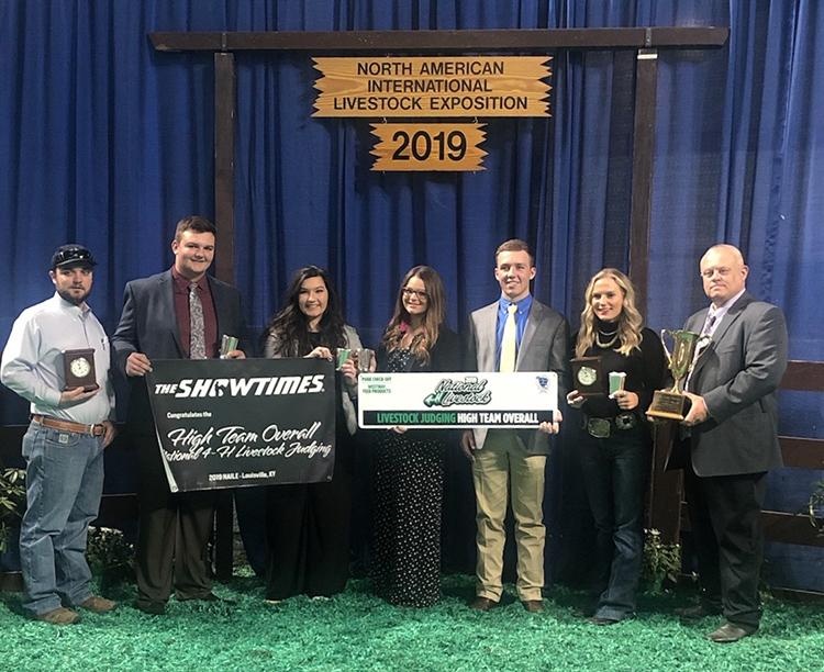 Kentucky 4-H'ers starting second from left: Will Banks, Lydia Gosney, Chevy Vaske and Kasey Johnson won the state's first ever National 4-H Livestock Judging Competition. They are coached by Steve Austin, right.