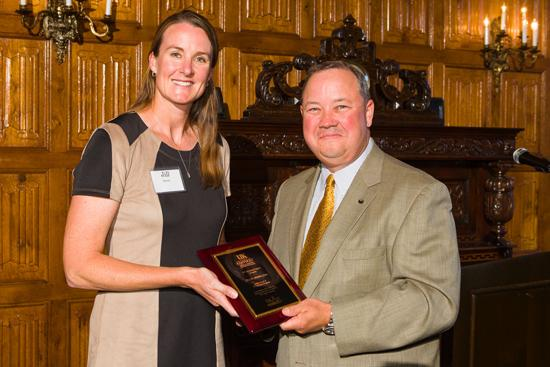 Jill Stowe, left, presents Stuart Brown with the Friend of UK Ag Equine Programs award.
