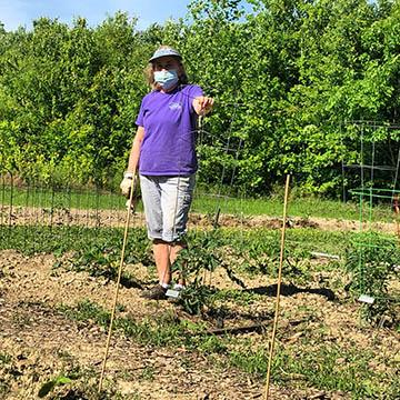 Master Gardener Cindy George in one of the many community gardens in Louisville