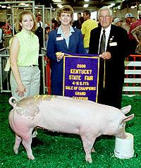 Donna Hancock accepts the banner for her grand champion market hog.