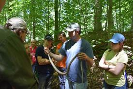 instructor in woods with snake