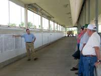 The walking tour of the Animal Science Beef Unit included a stop in one of the feeding facilities.