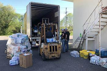 Loading a semi with fencing materials and cleaning supplies at the Graves County Cooperative Extension office. The materials will be headed to Nebraska to help farmers impacted by record flooding in March 2019. Photo by Samantha Anderson
