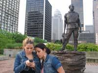 With Yanay Mesa looking on, Anatiel Santiesteban reset a GPS receiver near the statue of York on the Belvedere in downtown Louisville.