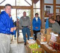 Mark Reese, far left, and tour participants listen  to a presentation at Amerson Farm Orchard.