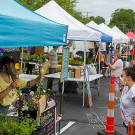 Farmers and customers practice social distancing at the Lexington Farmers Market. Photo by Matt Barton