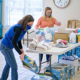 Wolfe County extension agents, Heather Graham, foreground, and Alyssa Cox, sort through donations at the Wolfe County Extension office. Photo by Matt Barton, UK agricultural communications.