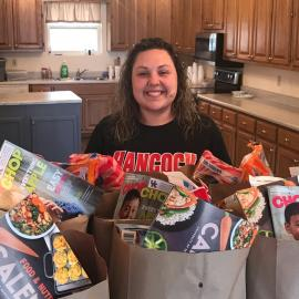 Bethony Morris, NEP assistant in Hancock County, packs groceries for her clientele.