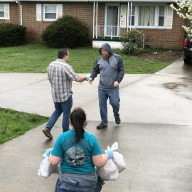 Lewis County NEP assistant Brad Stone, ctr left, distributes food to clientele early in the pandemic.