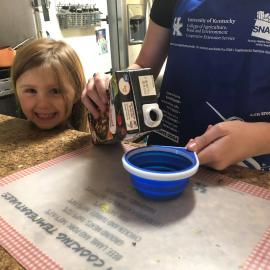 A little girl enjoys cooking with her mom with help online from Perry County NEP assistant Reda Fugate.