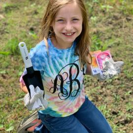 A young girl prepares to grow a Victory Garden with tools and seeds he received from Perry County NEP assistant, Reda Fugate.