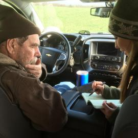 Richard Preston and Hanna Poffenbarger go over data from field trials in pre-pandemic times. Photo by Chad Lee