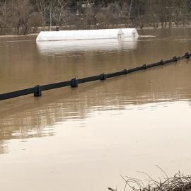 High tunnels under water at UK's Robinson Center for Appalachian Resource Sustainability after torrential rains hit the area. Photo by Daniel Wilson