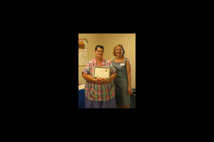 Ann Wynn, left, receives a certificate honoring her weight loss achievement. Also pictured is Christine Rivera, Caldwell County family and consumer science agent.