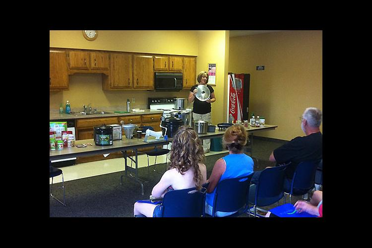 Laura Peek, Washington County EFNEP assistant, demonstrates food preservation techniques during the Back to Basics program.