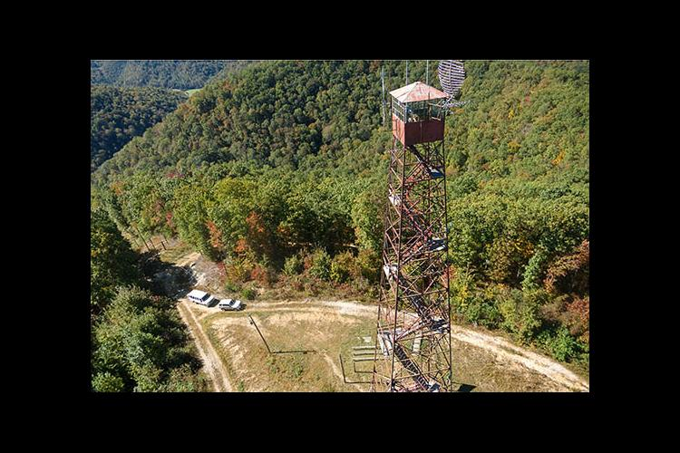 Aerial view of the fire tower in UK Robinson Forest.