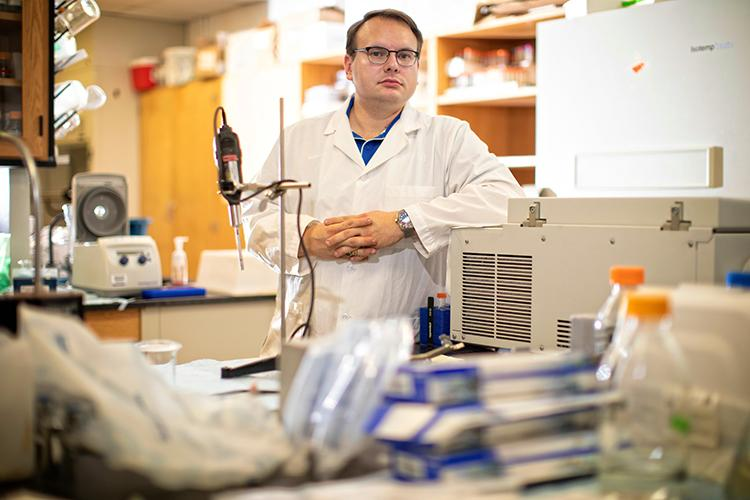 Stuart Lichtenberg, pictured in his lab at the Agriculture Science Center North, will graduate Dec. 20 with a Ph.D. in integrated plant and soil science. Mark Cornelison   UK Photo.