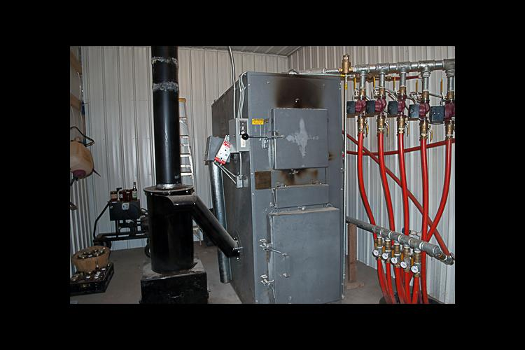 Hart County farmer Paul Dennison installed this biomass gasification boiler to improve his energy efficiency earlier this year.