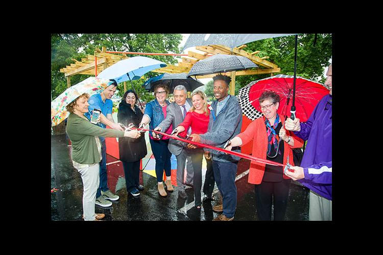 The ribbon is cut on Rakeem Bradshaw's pop-up installation on Southland Drive in Lexington.