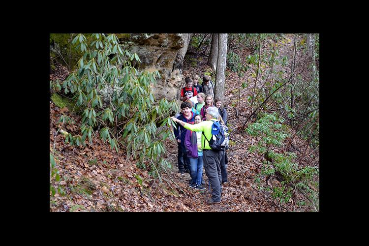 Greg Whitis leads McCreary County seventh-graders on a hike to the Natural Arch.