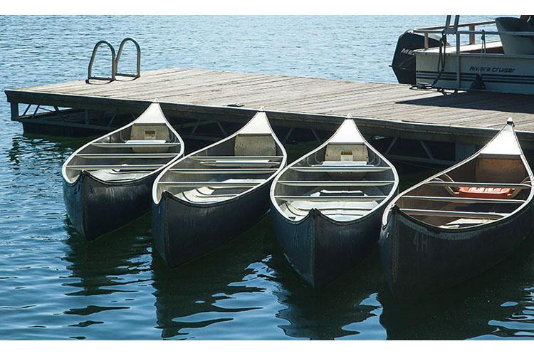 Canoes on the lake at Lake Cumberland 4-H Camp. Photo by Matt Barton, UK agricultural communications.