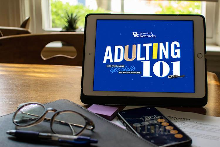 Tablet with Adulting 101 logo on the screen