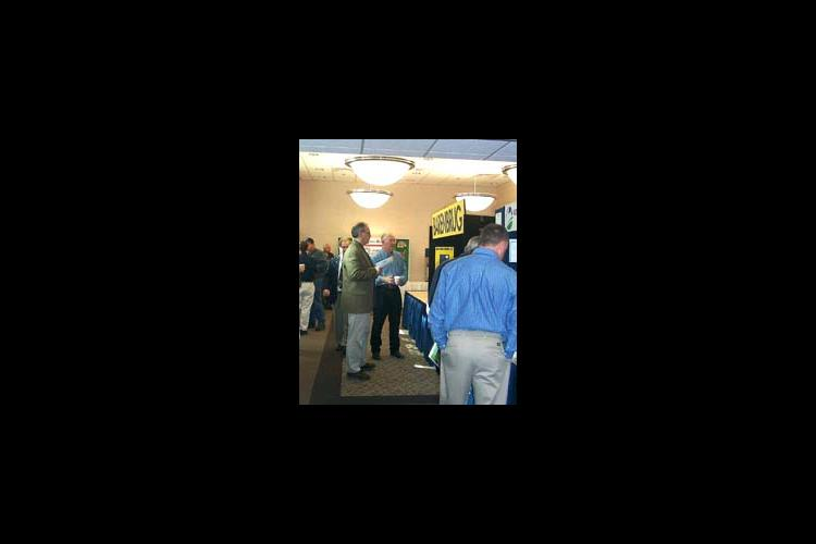 UK Extension Forage Specialist Jimmy Henning talks with visitors at the annual alfalfa conference in Cave City.