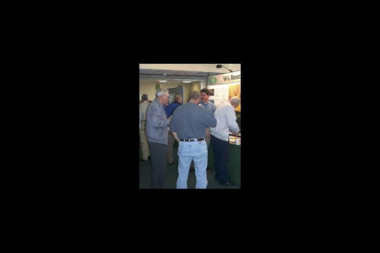 Visitors look over exhibits during a break at the 21st annual Kentucky Alfalfa Conference in Cave City.