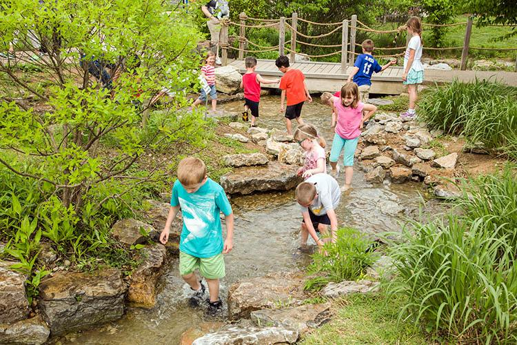 Kids enjoy the Kentucky Children's Garden at The Arboretum on Arbor Day, 2017