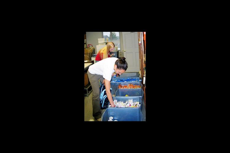woman selecting food from bin