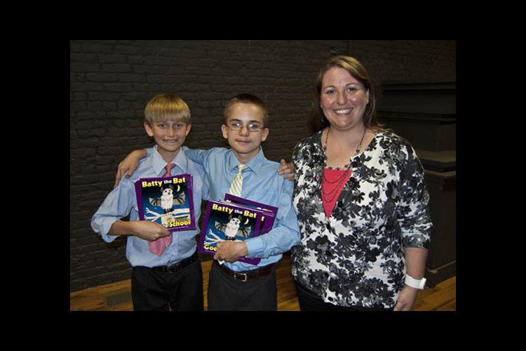 Fifth-grade students Dylan Hood and Isaac Shackleford and their teacher Christina Anderson