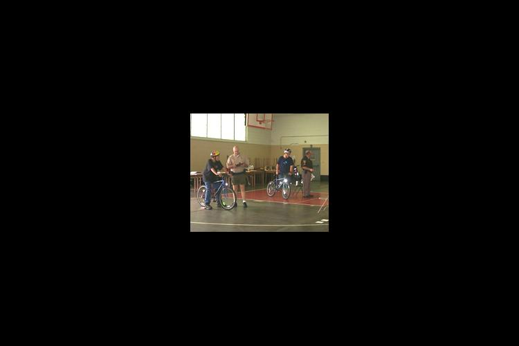 Jefferson County police officers act as judges and provide safety training for all the 4-H bike rodeo contestants