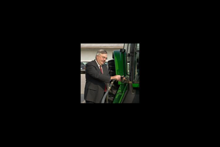 Interim Provost Scott Smith fuels a UK farm tractor with biodiesel during the October 14 ceremony.