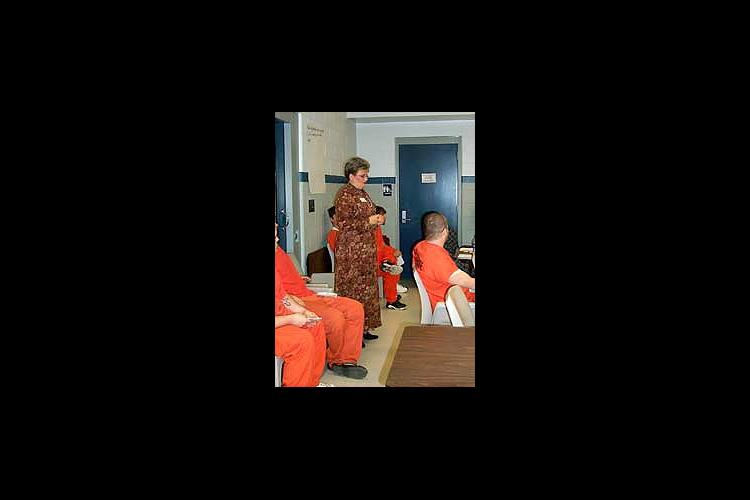 woman speaking to inmates