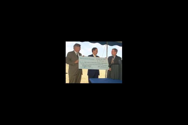 Dr. Scott Smith (left) and Dr. Lee Todd (middle) accept the research funding check from U.S. Senator Mitch McConnell.