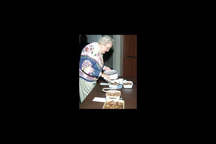 Doris Maclin, Leestown Homemaker Club leader, gets ready to taste 3 different roast samples.