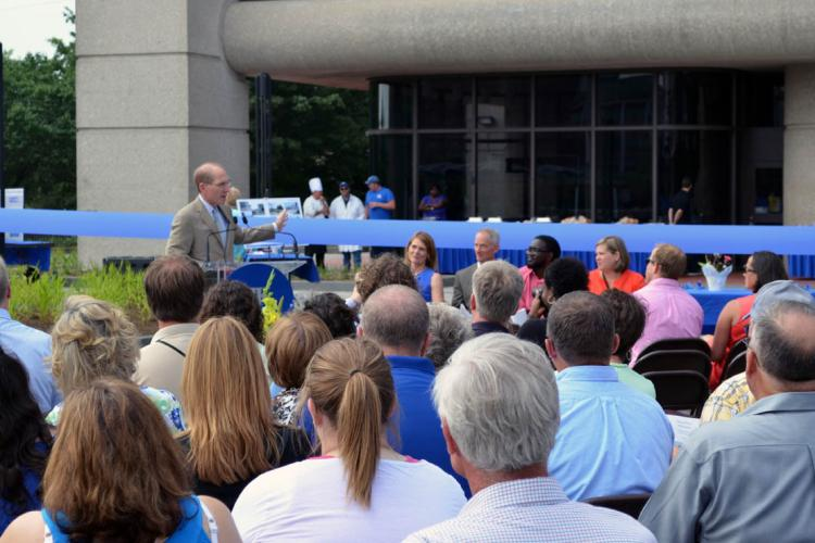 UK President Eli Capilouto addresses people gathered for dedication of CAFE Alumni Plaza.