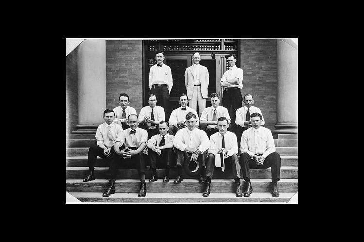 A photo of the early county extension agents, likely taken in 1920. Charles Mahan is on the back row, far right.