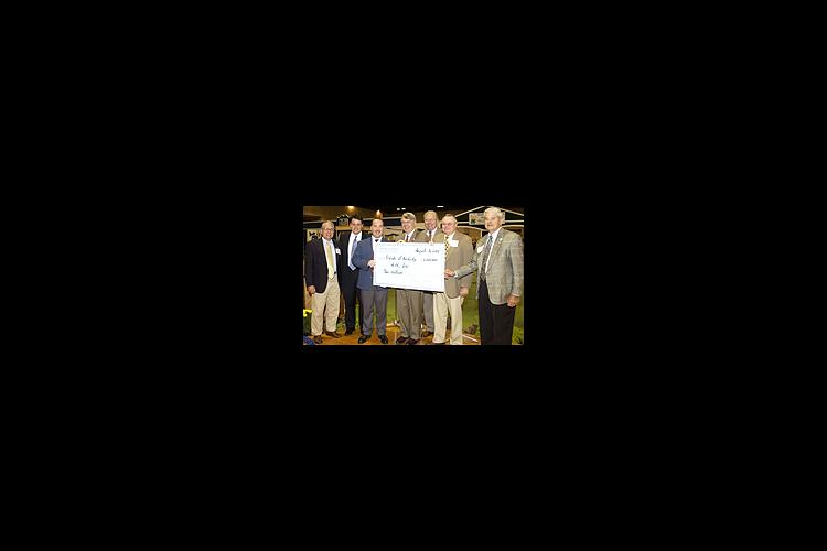 UK dean of agriculture Scott Smith (center) holds the 4-H $2 million check with Kentucky agriculture commissioner Billy Ray Smith (far right) and members of the Kentucky Agricultural Development Board during the 4-H Friends breakfast at the State Fair.