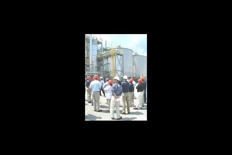 people with hard hats touring the Kentucky Ethanol Production Facilities