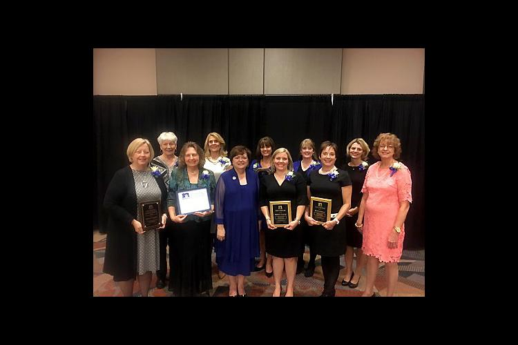 UK award winners post with Theresa Mayhew, NEAFCS president, front, third from left.
