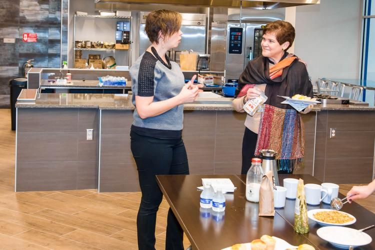 Lilian Brislen (left), Exec. Dir. of The Food Connection @ UK talks with USDA Deputy Secretary of Agriculture Krysta Harden