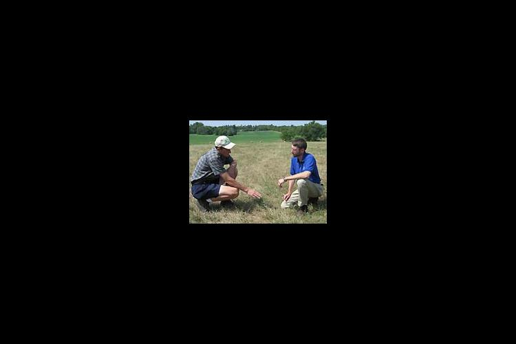Todd Clark, left, talks to UK Forage Specialist Ray Smith about the condition of his pastures.