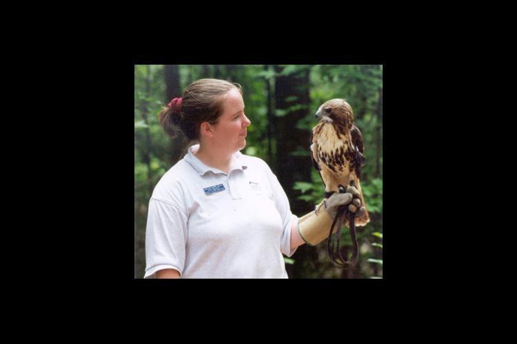 Geri Philpott holds a raptor