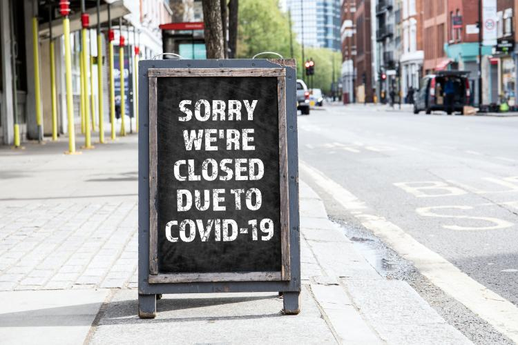 Sign announcing store closing due to COVID-19
