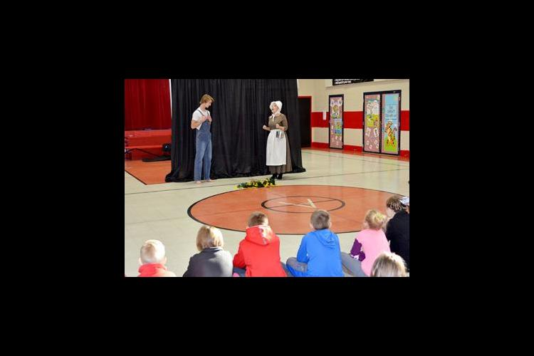 """Eli Raby, left, and Anne Stephens act out a scene from Jesse Stuart's """"Old Ben"""" for Argillite Elementary third-graders."""